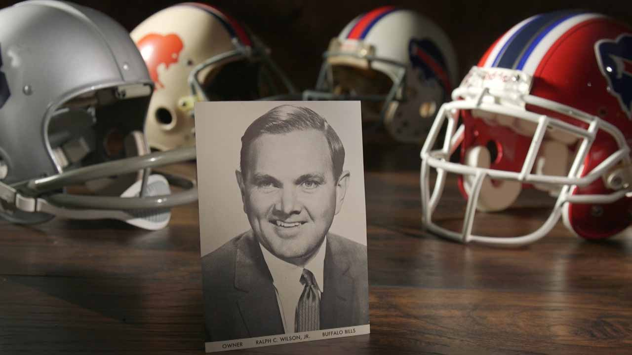 Buffalo Bills football helmets with a photo of Ralph C. Wilson Jr.