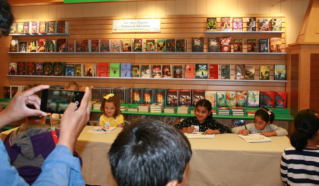 Winners signing their books at the 2017 Writers Contest Little Local Authors Event held at Barnes and Noble