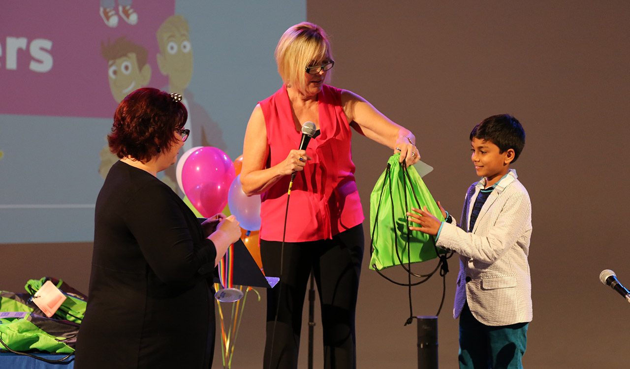 Mary handing prizes to a winner