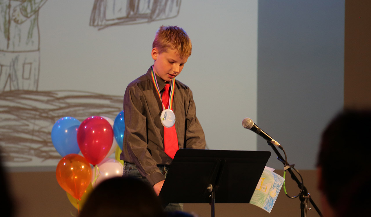 First Place 3rd Grade winner reads his story onstage in the studio at 2017 Writers Contest