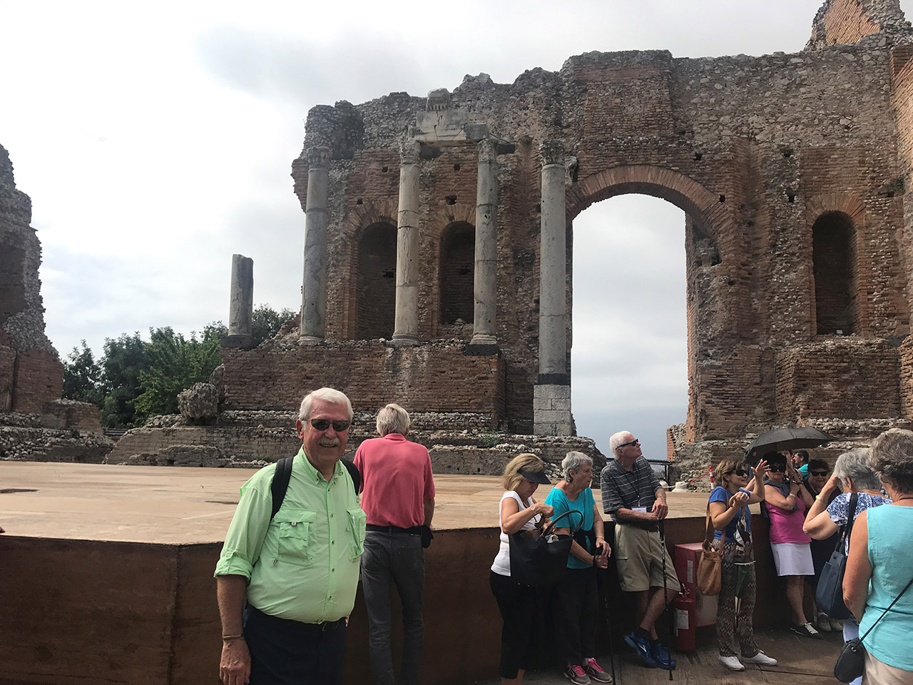 Travels and Chet Tomczyk standing in Greek theater