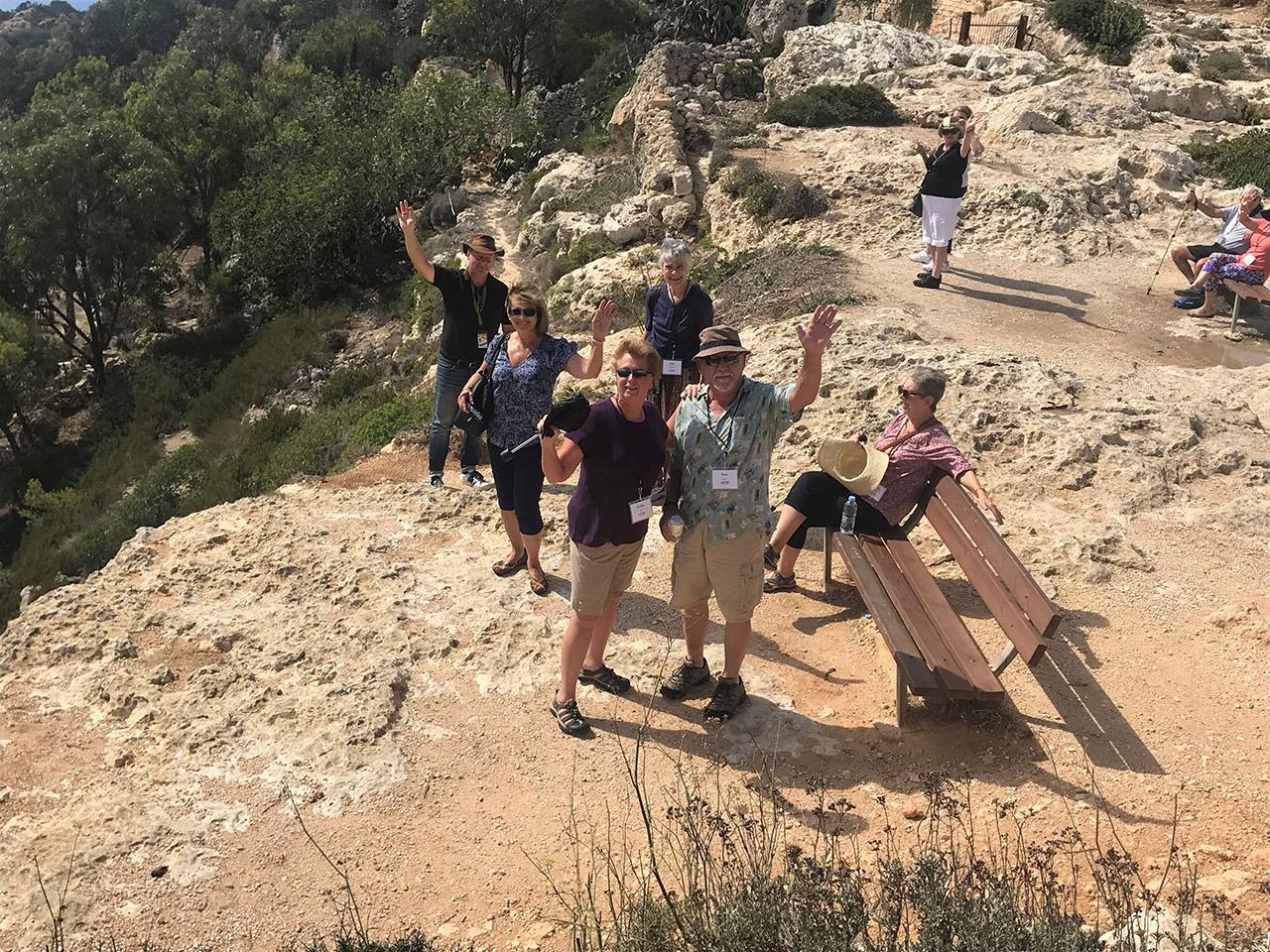 Travelers waving in Valetta Malta